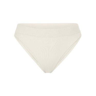 SKIMS cotton jersey cheeky tanga underwear in color Bone.