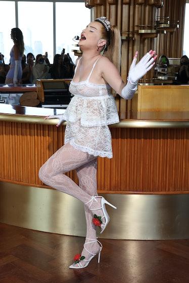 Kim Petras modeling for Maisie Wilen