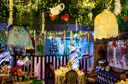 The decor at the 'Alice in Wonderland' bar in NYC has teapots and vines and is very cottagecore.