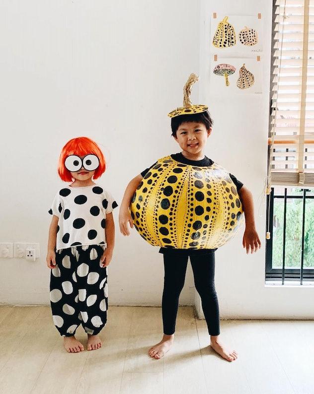 Kids dressed in costume as artist Yanoi Kusama, and her older brother dressed as Kusama decorated pu...