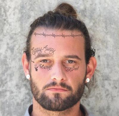 Man wearing Post Malone tattoos