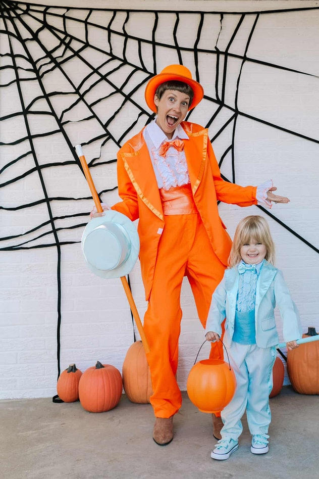 Mom and daughter in Halloween costumes from Dumb and Dumber, orange and blue suits