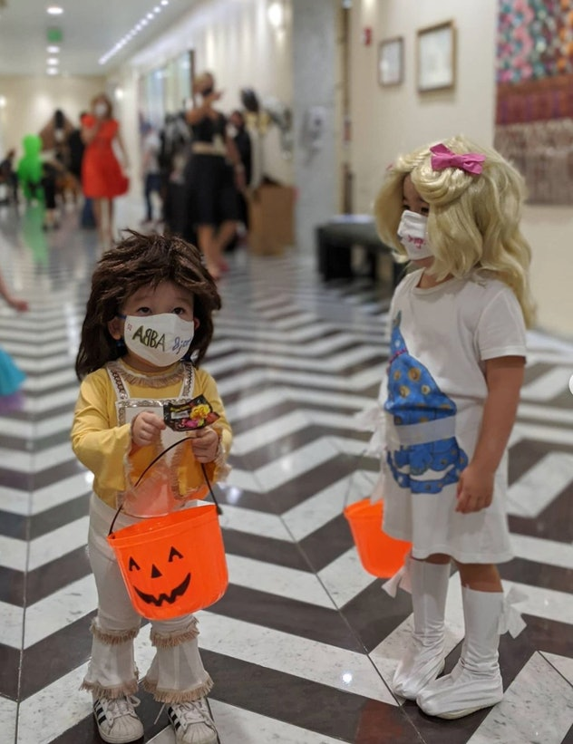 kids dressed in ABBA costumes for Halloween with wigs