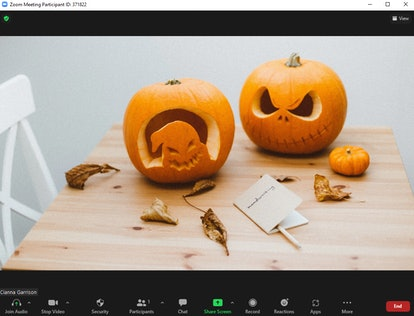 These Halloween Zoom backgrounds include a pumpkin carving scene.