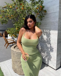 Kylie Jenner wears light green knit top and skirt on Instagram on August 10, 2021.