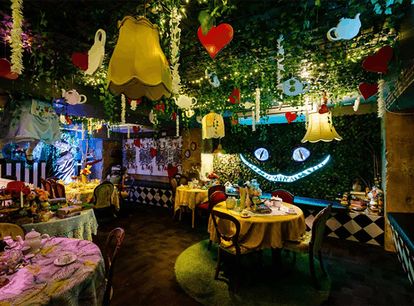 The 'Alice in Wonderland' bar in NYC has immersive experiences and a Cheshire Cat wall.