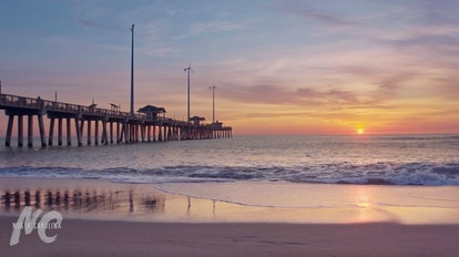 This beach background for Zoom shows a sunset view over Jennette's Pier in Nags Head, North Carolina...