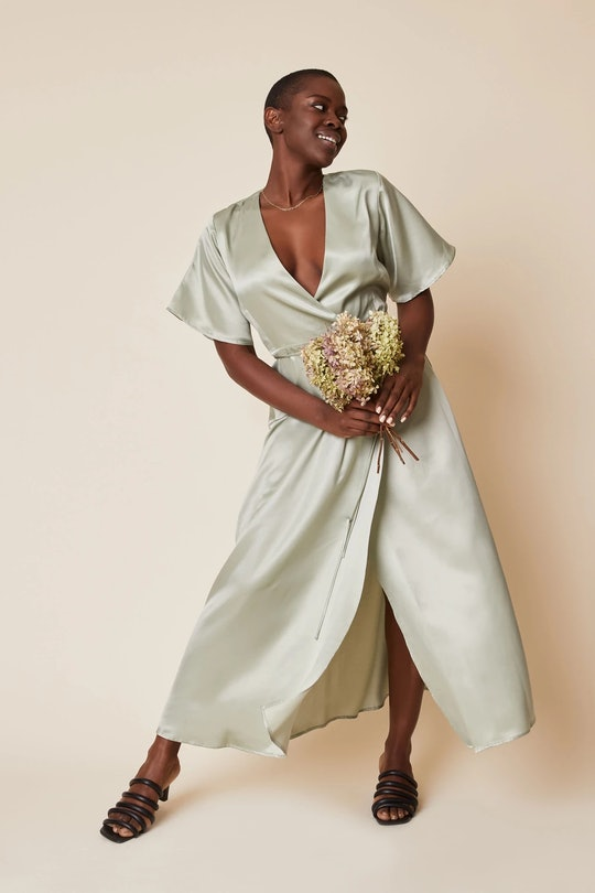 model wearing a silk-like wrap dress in light sage from sustainable brand whimsy + row