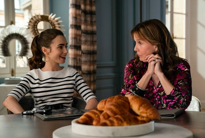 Lily Collins as Emily Cooper and Philippine Leroy-Beaulieu as Sylvie Grateux in Emily In Paris Seaso...