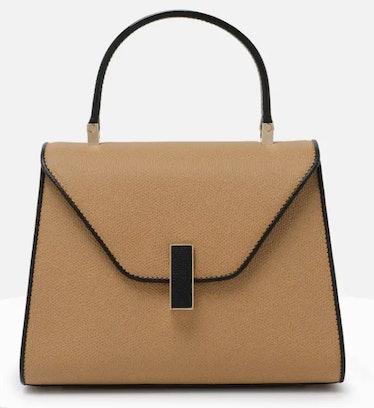 Valextra's Iside Mini Bag in camel black.
