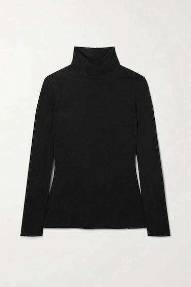 The Row's black turtleneck sweater.