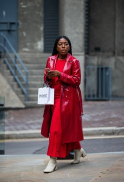 A guest is seen wearing red coat, dress outside RIXO during London Fashion Week September 2021 on Se...