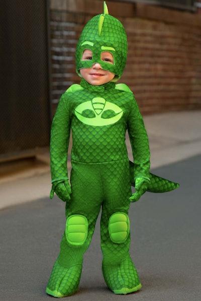 Toddler dressed as Gekko from PJ Mask