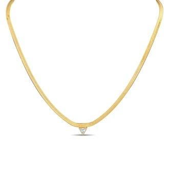 XIO By Ylette's gold creatrix necklace.