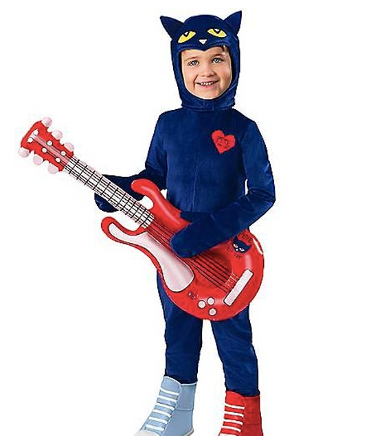 Boy wearing a Pete the Cat Halloween costume holding a fake guitar