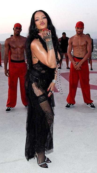 Rihanna blowing a kiss at the Savage X Fenty Vol. 3 runway show.