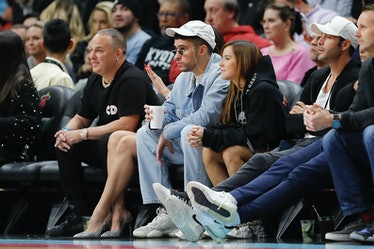 Music artist Bad Bunny looks on during the first half between the Miami Heat and the Dallas Maverick...