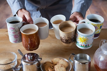 https://www.gettyimages.com/detail/photo/man-holding-many-tea-and-coffee-cups-royalty-free-image/112...