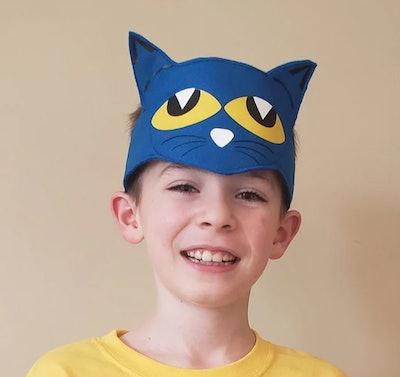 Boy wearing Pete the Cat headband
