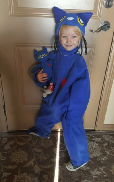 Little girl dressed in Pete the Cat costume