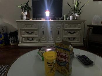 Hurricane Ida power outage living room lit by lantern