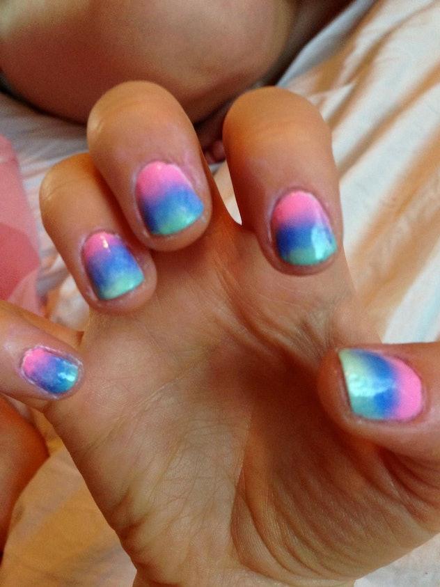 Up close image of manicure of gradient rainbow design