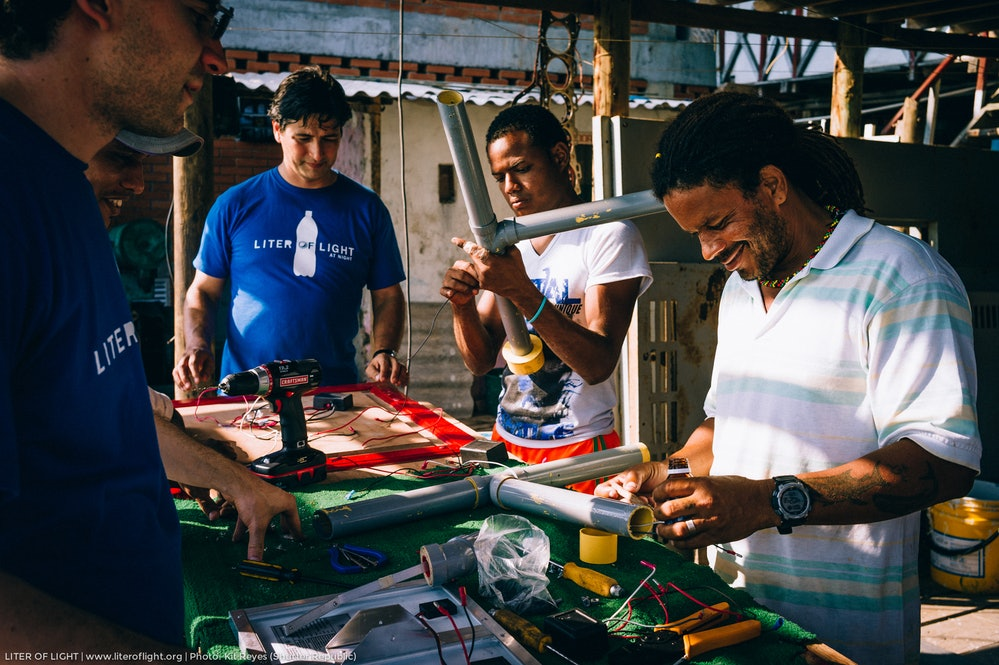 Illac Diaz building solar lights in Colombia.