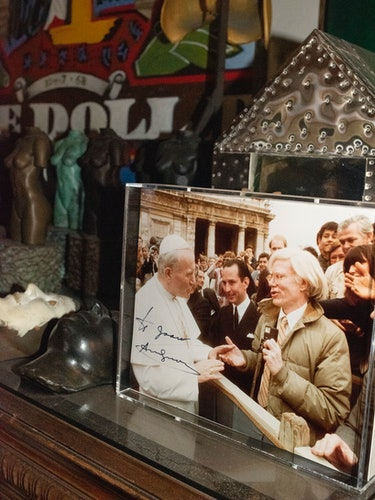 A photo of Andy Warhol and Pope John Paul II, autographed and gifted to Quinn by  the artist.