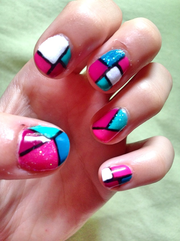 Close up of manicured nails with abstract designs
