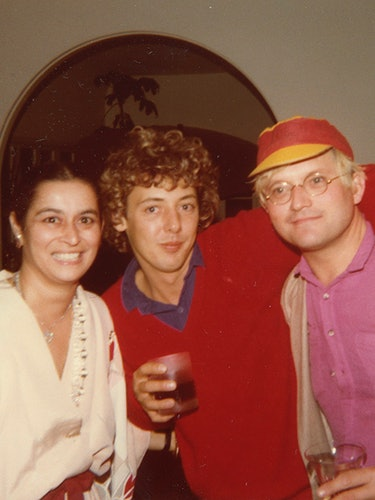 Quinn with Gregory Evans (center) and David Hockney at the Quinns' home, 1979.