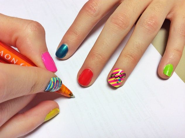 Close up of manicured nails, multi colored with stripe details
