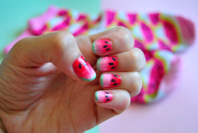 Closeup of manicure made to look like watermelons