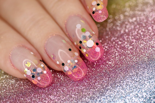 Close up of fingernails with art to look like glitter/confetti