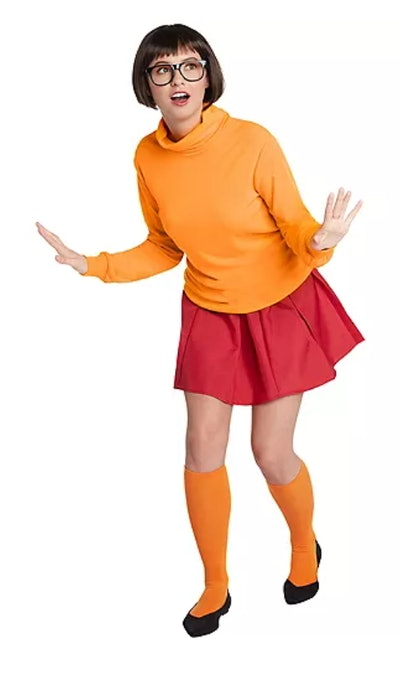 Adult woman dressed as Velma from Scooby Doo
