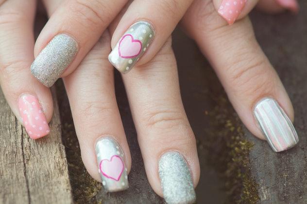 Close up of nail art, sparkles, hearts, stripes, polka dots