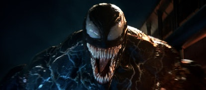 A still from the movie 'Venom' with Venom opening his mouth in a snarl to show his rows of teeth.