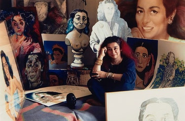 Quinn in the late 1980s, surrounded by a few of the portraits  of her.