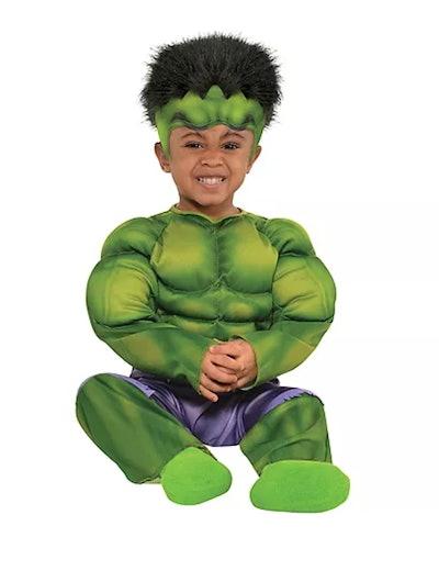 Baby dressed in Hulk costume