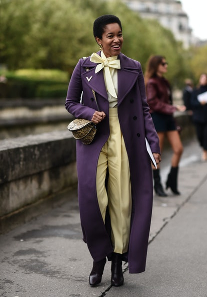 Tamu McPherson is seen wearing a Valeinto purple coat and yellow top and pants outside the Valentino...