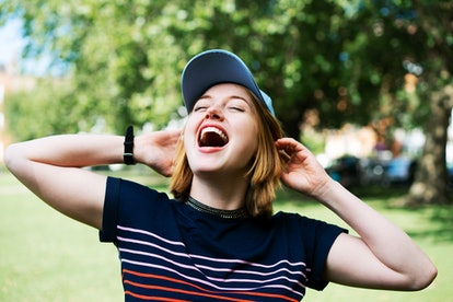 Young woman happy screaming on October 15, 2021, the best day of the month for her zodiac sign.
