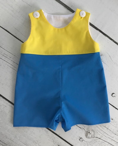 Flat lay of Christopher Robin costume for babies