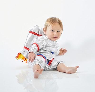 Baby dressed in astronaut costume