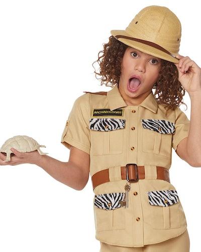 Young girl dressed in safari costume