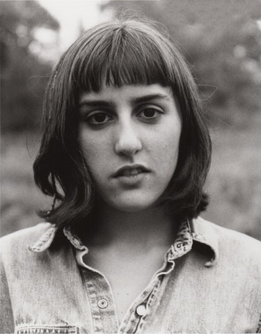 A black and white, closeup photo of Ry Russo-Young