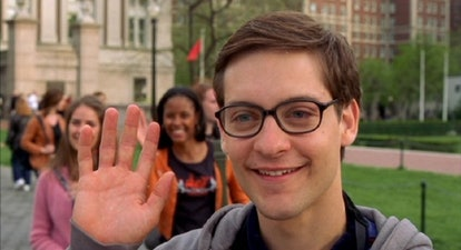 A still from 'Spider-Man' with Peter Parker (Tobey Maguire) in glasses, waving.