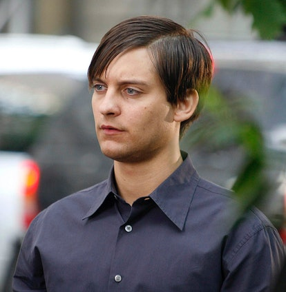 A still of Tobey Maguire on the set of 'Spider-Man 3,' with dark hair and a button-down.