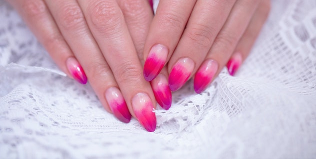 Closeup of pink and purple ombre manicure