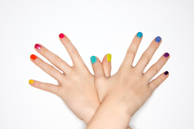 Manicure, each fingernail a different color of the rainbow