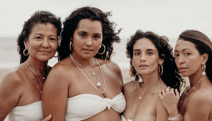 Four models wear BYCHARI jewelry in an Instagram post from August 26, 2021.
