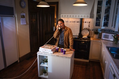 David Aarquette, aka Dewey Riley from 'Scream,' stands in the original 'Scream' house kitchen which ...